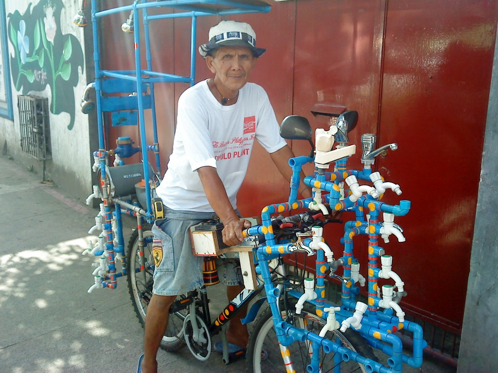 """Manong the plumber and his piped out bike"""
